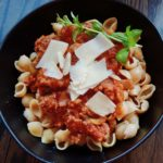 This Sausage & Mushroom Bolognese recipe can be whipped up in about an hour in an Instapot (pressure cooker.) Or make it on the stovetop or in a crockpot. - Grownupdish.com