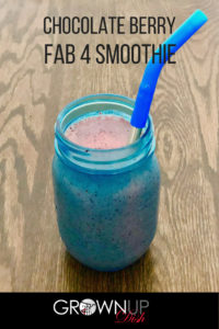 This Chocolate Berry Fab Four Smoothie is made with mixed berries and chocolate so it's deliciously sweet and a little bit savory. And because it follows Kelly Leveque's Fab Four formula, it will elongate your blood sugar curve and keep you full for several hours. | www.grownupdish.com