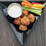 This healthy baked buffalo chicken meatball recipe is savory, spicy and oh so delicious. Serve an appetizer or pile them on top of greens for a satisfying meal. | grownupdish.com