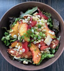 Destined to become your favorite healthy summer salad, this recipe features fresh sweet corn, juicy sweet peaches and tomatoes with a lemon basil vinaigrette. It's Paleo, Whole30, Sugar-Free, Gluten-Free and Vegetarian. | www.grownupdish.com