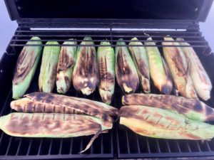 """Here's a super easy """"recipe"""" for cooking corn-on-the-cob on the grill. This is my preferred method because the corn cooks right in the husks, eliminating most of the mess that comes from shucking. You shuck the corn AFTER it is cooked, and it's less messy because the silk slides right off with the corn husk. 