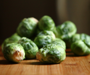 These healthy and easy Crock-Pot Brussels Sprouts have three ingredients and they come out perfectly every time.  They're sugar-free, gluten-free, paleo, vegan and Whole30. | www.grownupdish.com
