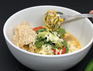 If you like big spicy flavor and toppings galore, Easy Mexican Soup features chicken,white beans, zoodles, and a hit of fresh Jalapeño and lime juice. | www.grownupdish.com