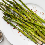 This oven roasted asparagus recipe is quick (20 minutes), easy (4 ingredients), healthy and (most of all) delicious. Vegan, Whole30 and keto - try it today! | www.grownupdish.com
