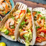 Healthy Weeknight Shrimp Tacos are spicy, flavorful and ready in 30 minutes. Recipe includes Whole30 and gluten-free variations as well as timesaving tips. | www.grownupdish.com