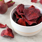 Homemade beet chips have all the crunchy satisfaction of a potato chip with none of the guilt. And they are ridiculously easy to make with this easy recipe. | www.grownupdish.com