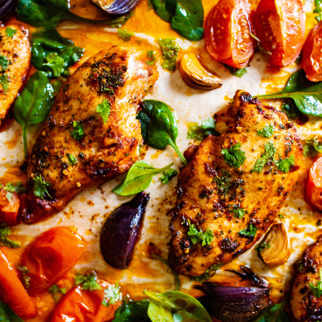 Honey Harissa Sheet Pan Chicken & Vegetables is so versatile and easy that it'll become your favorite weeknight dinner recipe. Try it! | www.grownupdish.com