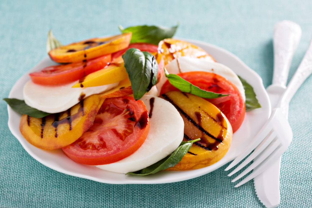 """There's a saying that goes """"What grows together, goes together."""" With peaches and tomatoes in season and plentiful, this super simple Peach and Tomato Caprese Salad is a lovely way to enjoy them. Just four ingredients and it's on the table in minutes. 